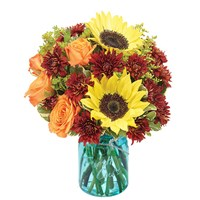Harvest-Bouquet-filled-with-yellow-sunflowers-orange-roses-in-mason-jar